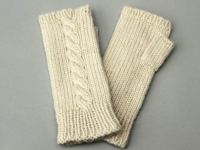 Hand knitted cabled fingerless mittens in undyed fine British wool – Small