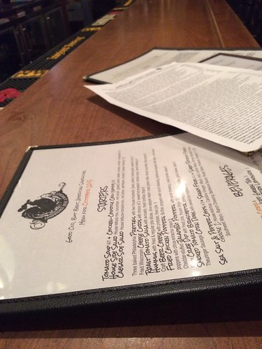 A close up of Jerry's menus on a bar.
