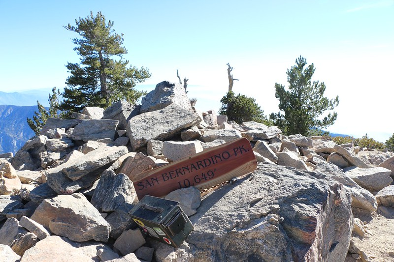 New wooden summit sign and old register on San Bernardino Peak