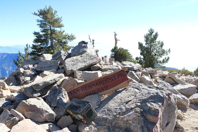 New wooden summit sign and old register on San Bernardino Peak