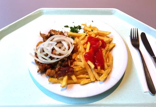 Greek pork gyros with tzatziki, fresh onions & french fries / Griechisches Schweinegyros mit Tzatziki, frischen Zwiebeln & Pommes frites