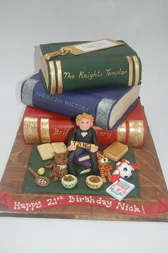 Quite a project, this one! Three different flavoured book cakes in the background and Nick himself in the foreground surrounded by all things dear to him! (The figure and objects are modelled on their own little board, so they can be retained as a keepsake). Nick's Bookstack Cake - from £120.