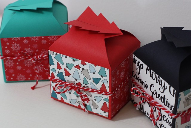 Christmas gift boxes with StickerKitten Penguins and Presents paper