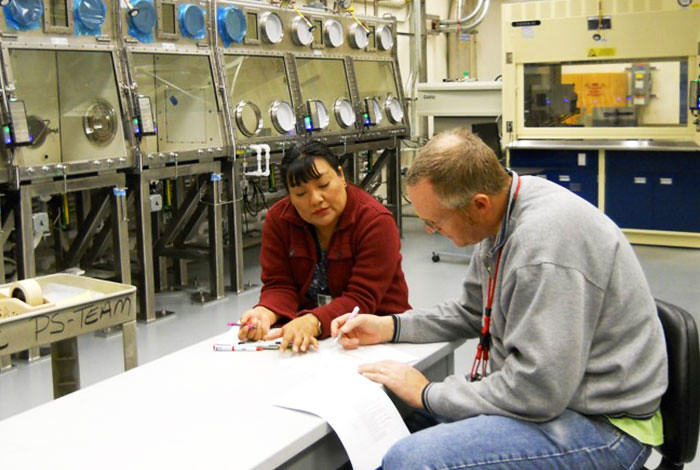 Denise Thronas and colleague Michael Schappert during a meeting in Los Alamos' Radiological Laboratory and Utility Office Building.