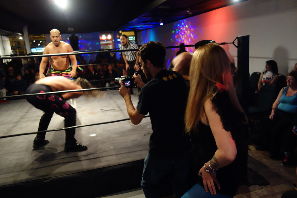 Raymi watches Hogtown Wrestling from behind the cameraman