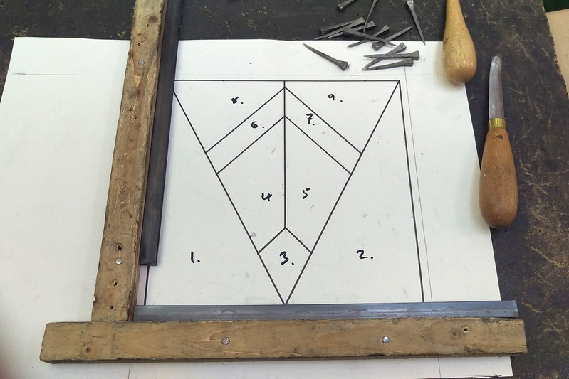 The design diagram nailed to a frame for leading