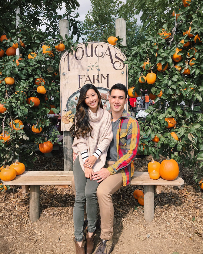 fall pumpkin patch engagement photos couple outfits