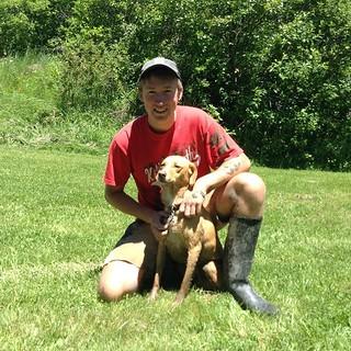 Student Luke Gersz with dog