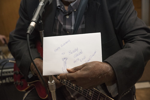 Bobby Green holds up a birthday card from The Stand's music columnist Reggie Seigler during the music legend's 80th birthday performance held at the B&B Cocktail Lounge Oct. 16. | Ben Cleeton, Staff Photo