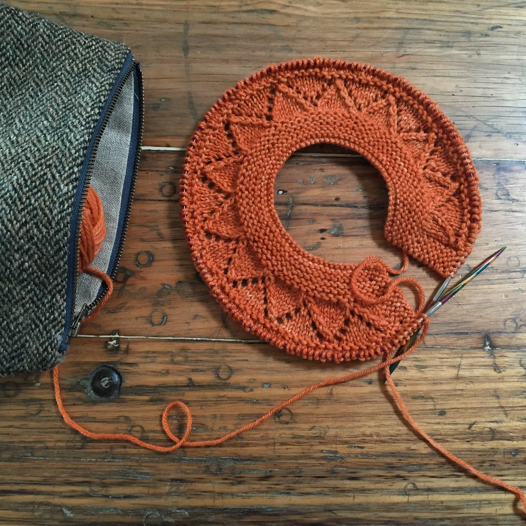 the start of a knitted cardigan, pattern is tikkiknits 'granny's favourite', in orange colinette cadenza
