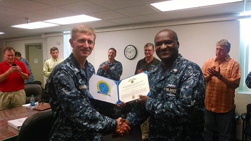 Award presentation for Information Systems Technician Senior Chief Kelvin G. Jackson