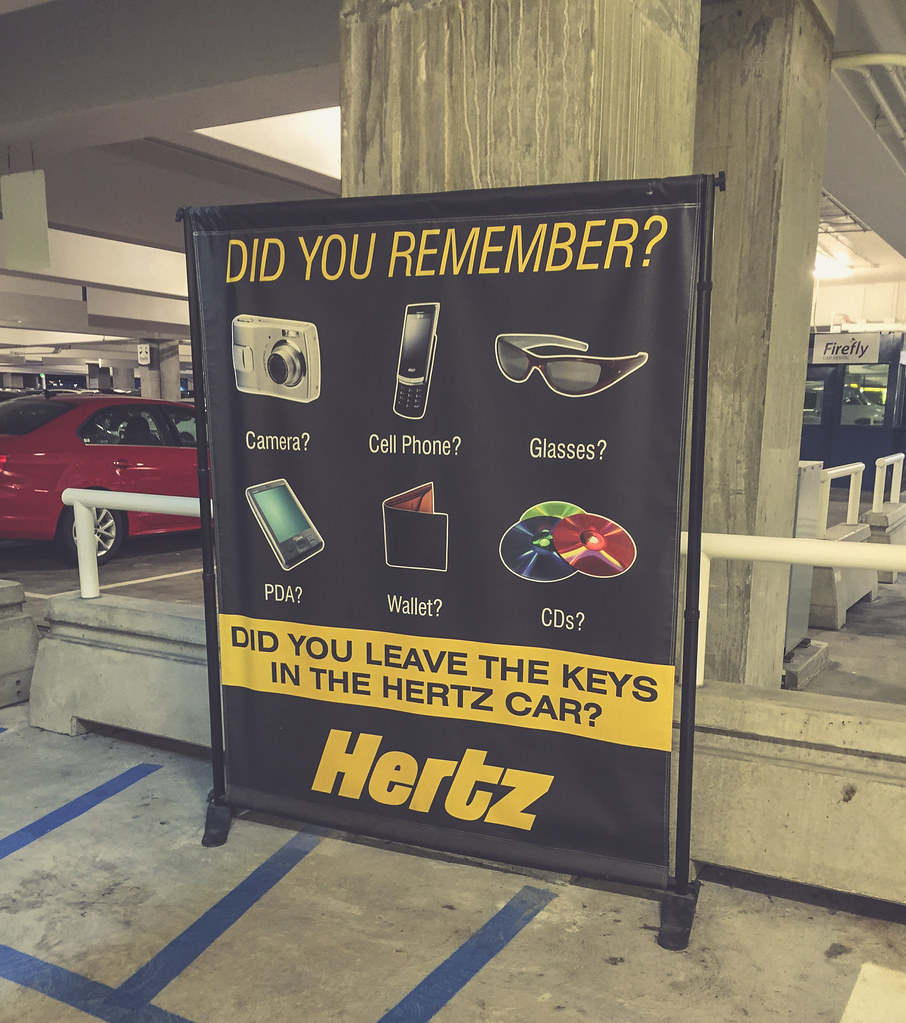 A Quite-dated Sign At The Hertz SeaTac