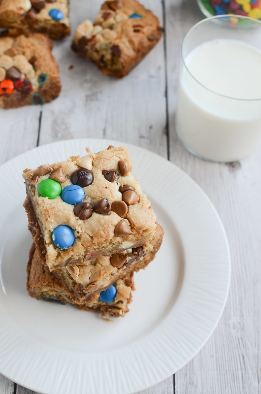 Loaded Cookie Bars - this easy recipe starts with a boxed cookie mix and are stuffed with chocolate, peanut butter, candy, and coconut!