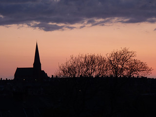 Pale sunset behind silhouetted St James church