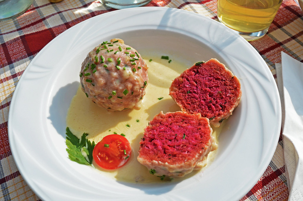 Eating beetroot knödels in South Tyrol