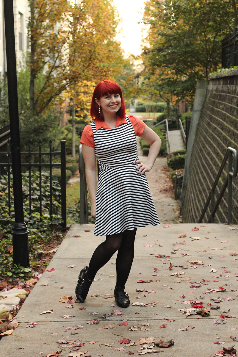 Striped Fit and Flare Dress Layered Over an Orange Blouse, Black Tights, and Ankle Boots