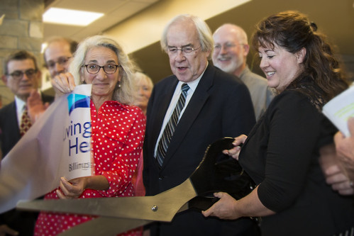 Dr. Laurel Desnick of Livingston HealthCare, Dr. Nick Wolter of Billings Clinic, and Livingston Hospital Board Chair Michelle Becker cutting the ribbon