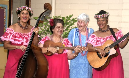Founder of Hawaii Meals on Wheels with noted island trio, Pumehana. Left to right: Mihana Souza, Iwalani Kahalewai, Irmgard Hormann, and 'A'ima McManus