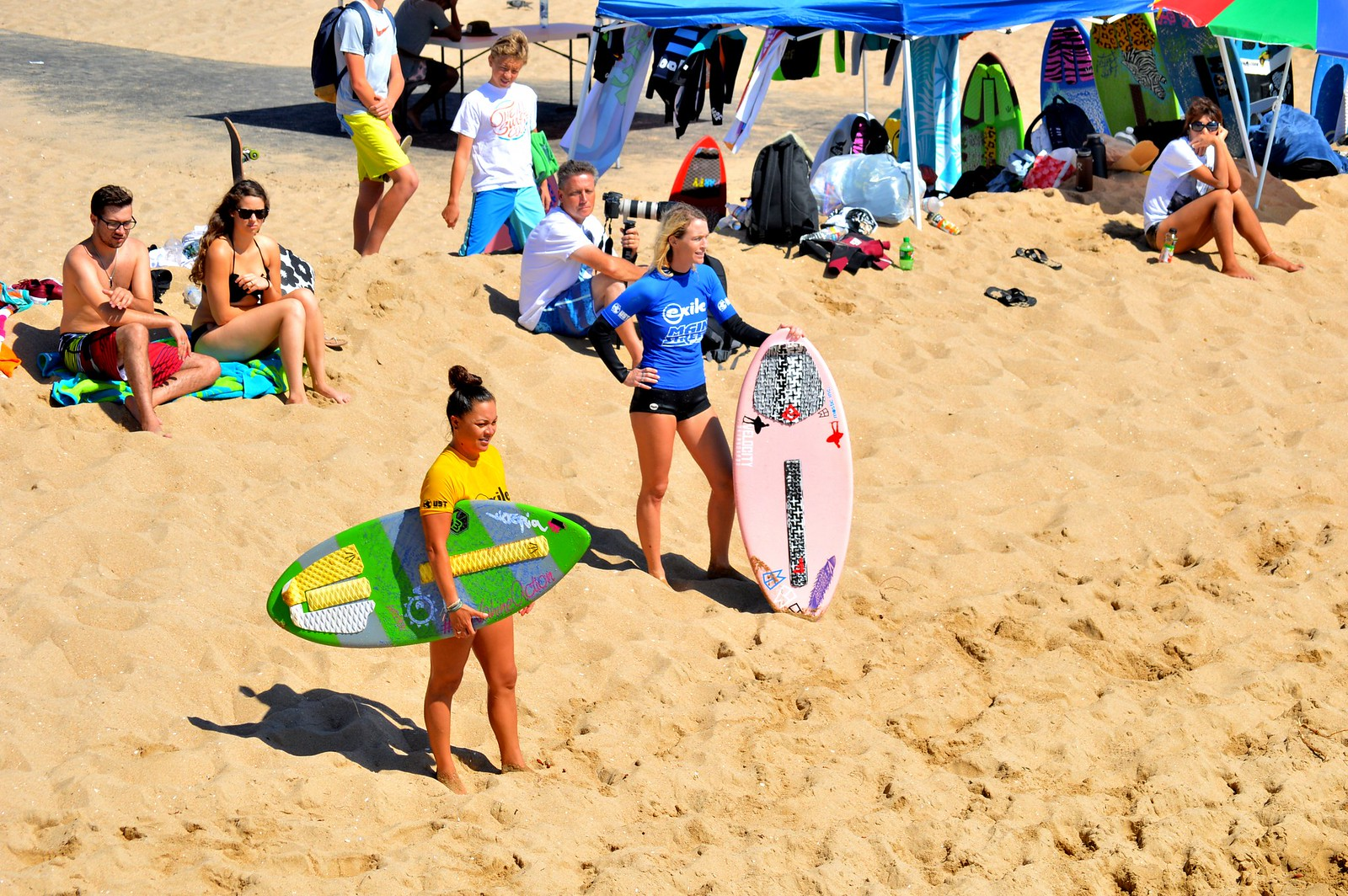 Female surfers participating in a competition at Huntington Beach, California.