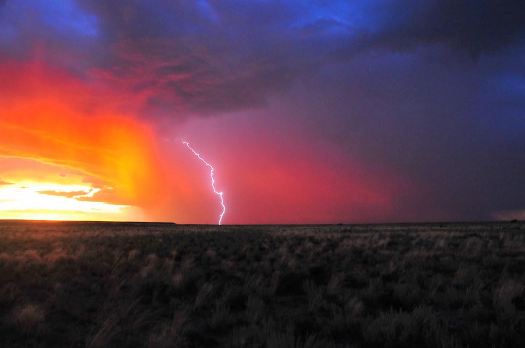 sunset storm with lightning over seedskadee national wildl