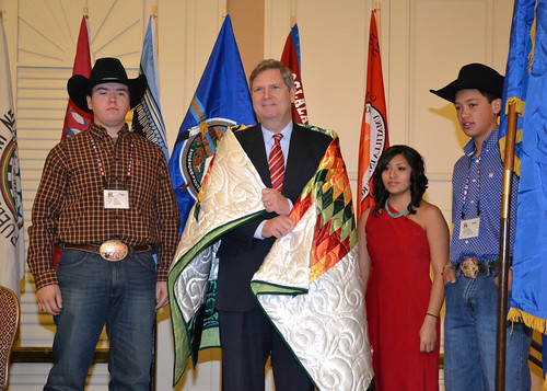 Agriculture Secretary Tom Vilsack presented with a blanket from the Pine Ridge Reservation, S.D.