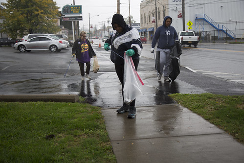 Denise Baker, Sarah Evans and Nyah Waters work together to clean up the neighborhood during the South Side cleanup organized by Believe in Syracuse on Oct. 8. | Aubrey Moore, Staff Photo
