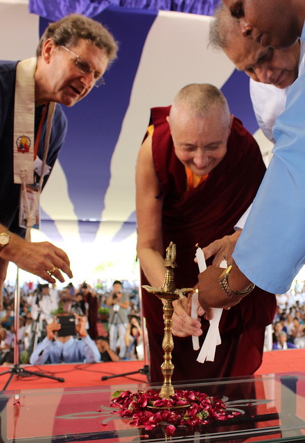 Photo 2 - Lokamitra, Jetsunma Tenzin Palmo, and Prof. Sukhdev Thorat lighting candles for the opening of the conference