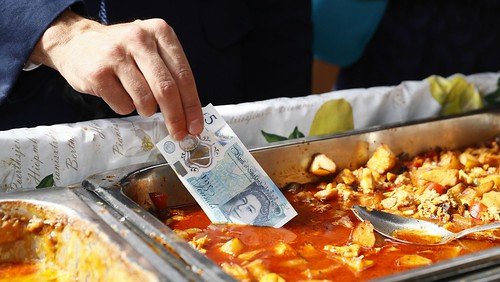 Dipping a fiver in curry sauce