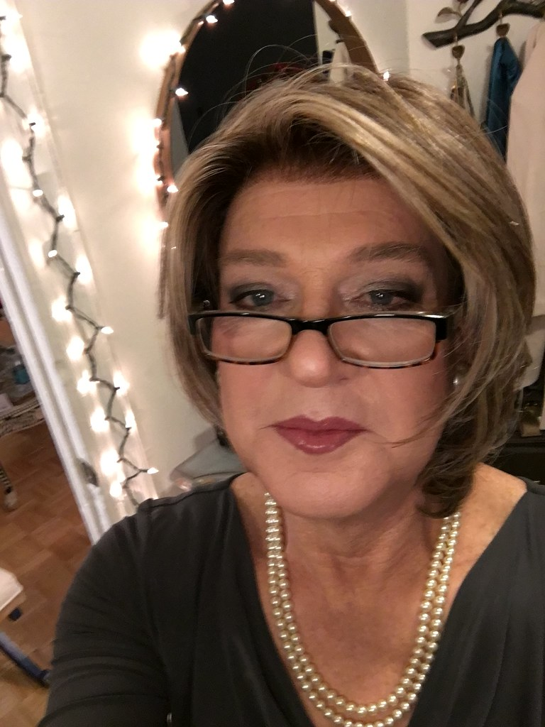 An Older Woman Taking Her Selfie And With A New Hair Do A -6927