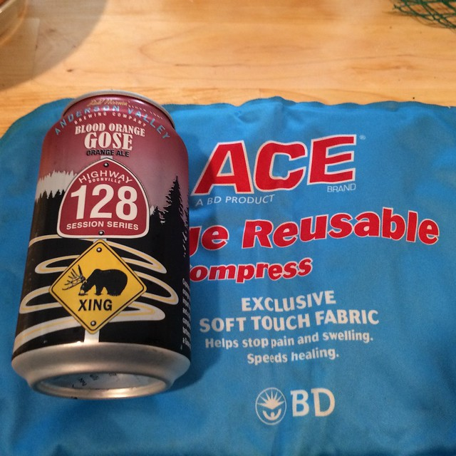 A can of Anderson Valley Brewing Company's Blood Orange Gose on the left hand side of an Ace cold pack.