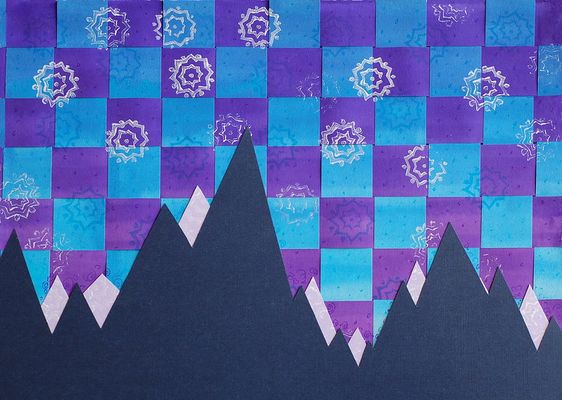 Artwork - mountains against a chequered sky