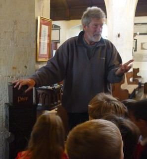 Town Guide John Pegg with children form Lostwithiel School