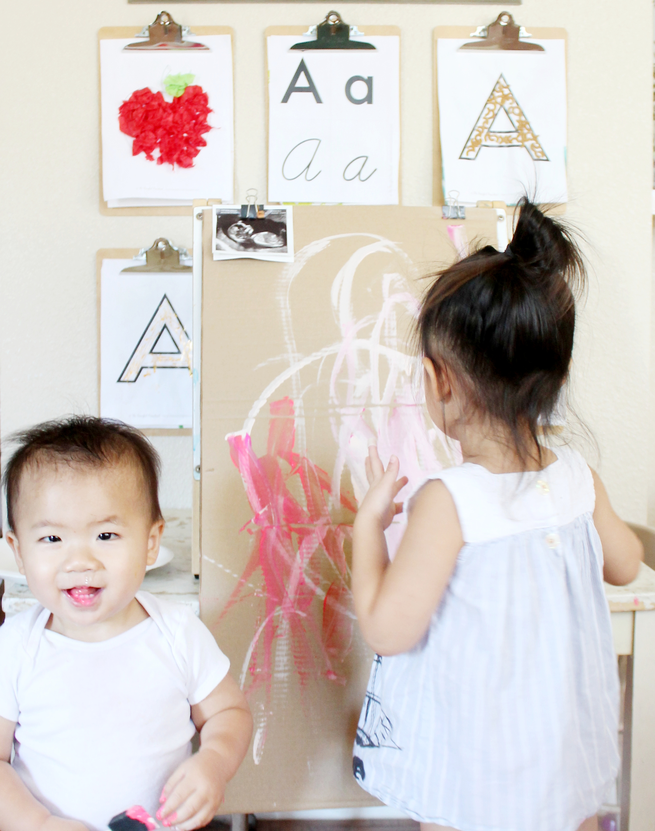 painting for their baby sister