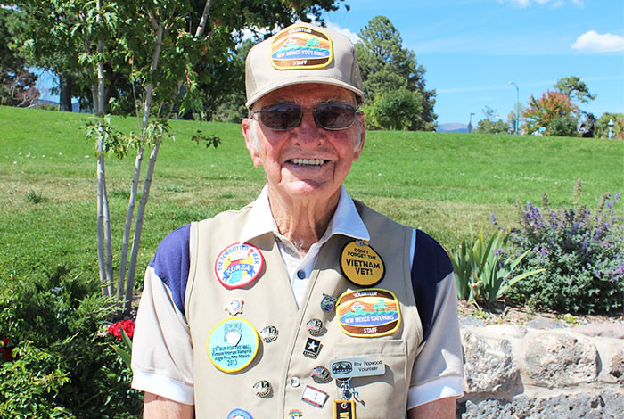 Laboratory retiree and volunteer Roy Hopwood is proud to wear buttons given to him by military veterans as a sign of appreciation.