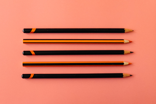 pencils arranged neatly on pink background