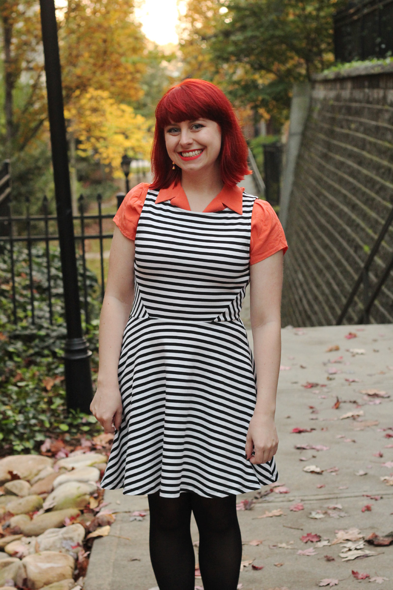 Black and White Striped Dress, Orange Button Down Blouse, and Bright Red Hair