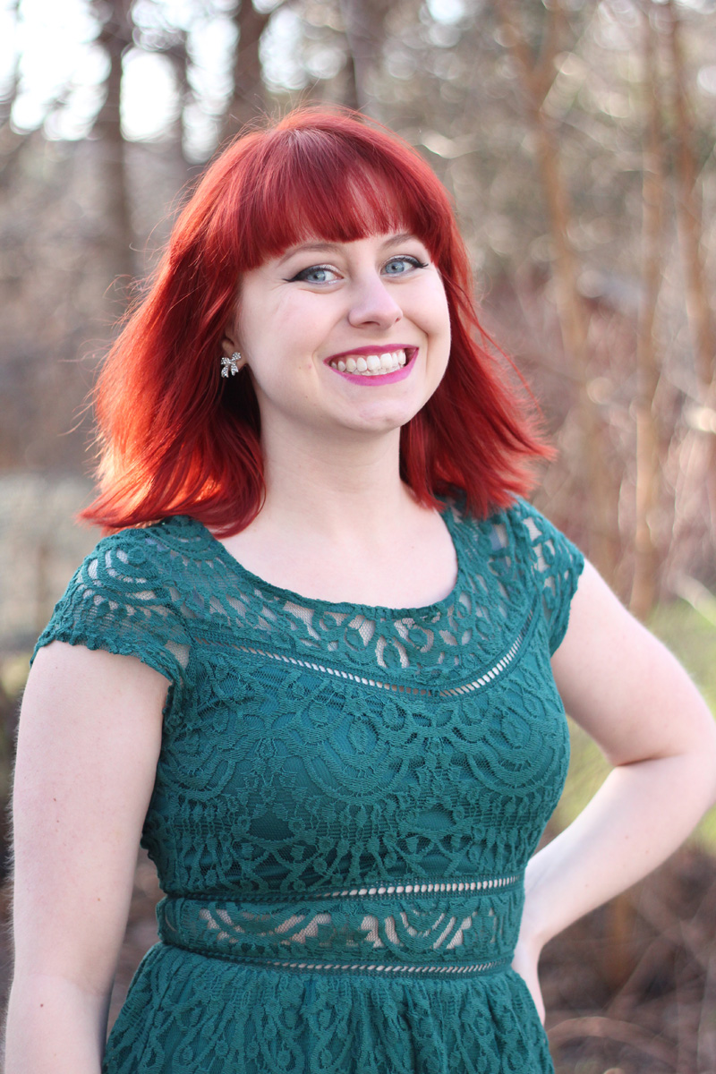 Bright Red Hair, Bow Earrings, and a Green Lace Dress