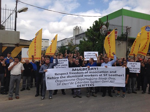 Deriteks members in Tuzla hold a protest outside of their factory with Deriteks signs and a sign calling out Mulberry