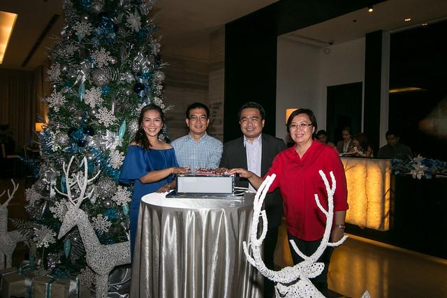 ADOS Kathy Namuag, RD Robby Alabado, Councilor Bernie Al-ag, and CTOO Generose Tecson does the ceremonial tree lighting