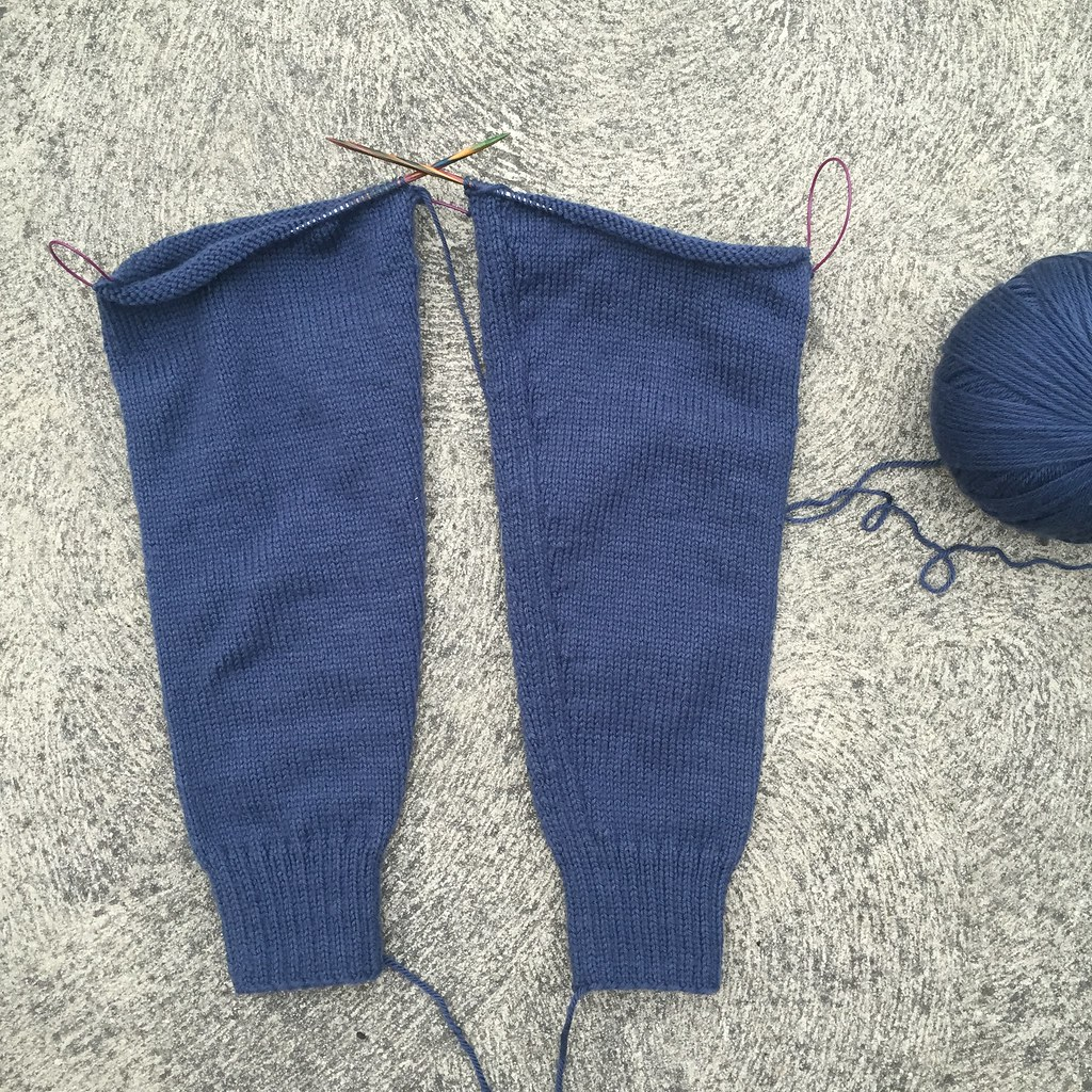 two, almost-finished sleeves, knit in bendigo woollen mills luxury in blue denim colourway