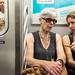 New York City Street Scenes - Two Women Talking on a Subway Train