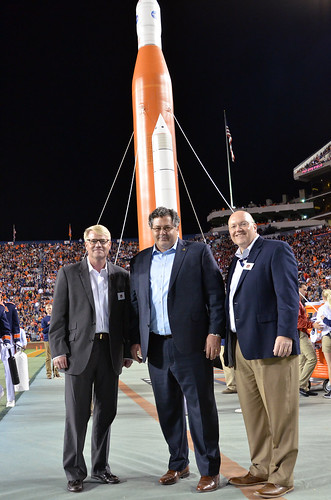 Mike Ogles, Todd May and Chris Roberts standing in Jordan-Hare Stadium during halftime.