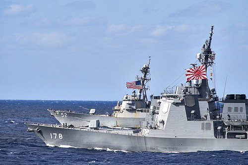 Japan Maritime Self-Defense Force guided-missile destroyer JS Ashigara (DDG) 178 ,front, and the Arleigh Burke-class guided-missile destroyer USS Barry (DDG 52), back, transits the Philippine Sea during a photo exercise as part of Keen Sword 17.