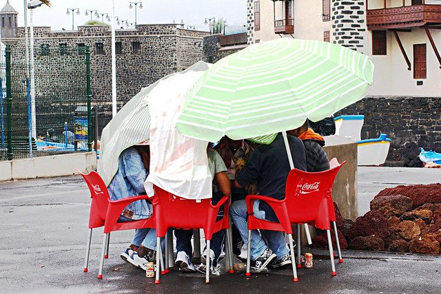 Card players in rain