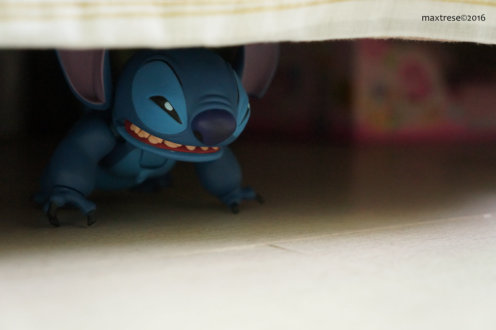 Revoltech Stitch hiding under the bed