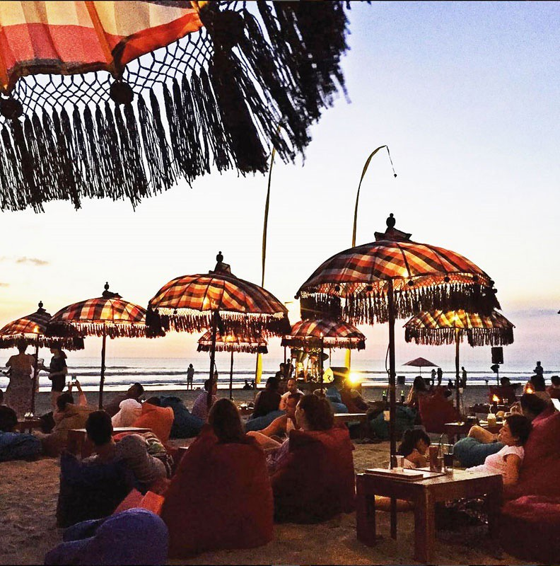 While Capil Has Plenty Of The Same Old Cosy Beanbags And Tables On The Beach Along With Great Views Of Those Famous Kuta Sunsets The House Band Truly