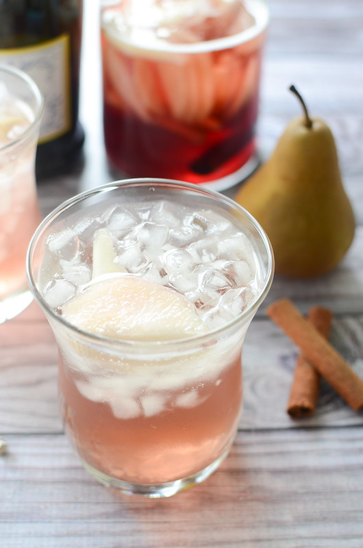 Pear Pomegranate Sangria - delicious white wine sangria with pomegranate juice, brandy, sliced pears, cinnamon, and topped with Prosecco. How delicious would this be for the holidays?