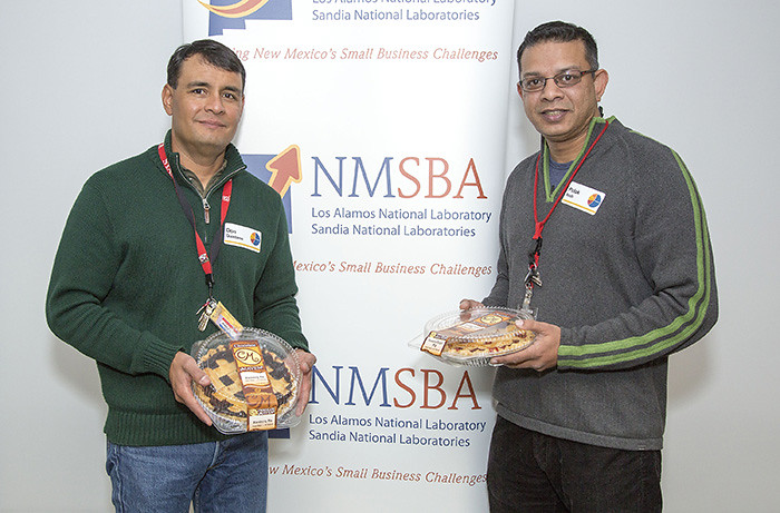 Don Quintana (left) and Pulak Nath (right) after winning their Principal Investigator Excellence (PIE) awards for their work helping small businesses through the New Mexico Small Business Assistance Program.