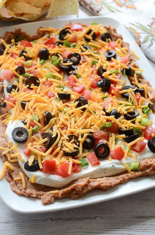 Layered Ranch Taco Dip - layered of refried beans, sour cream with ...