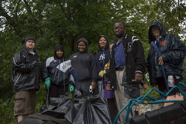 Pete Nicolini, Nyah Waters, Je'Niece Gallishaw, Denise Baker, Sarah Evans, Jerome Sanders and Arlene Brodbeck stand with the many bags of trash they collected Oct. 8, during the South Side cleanup organized by Believe in Syracuse. | Aubrey Moore, Staff Photo